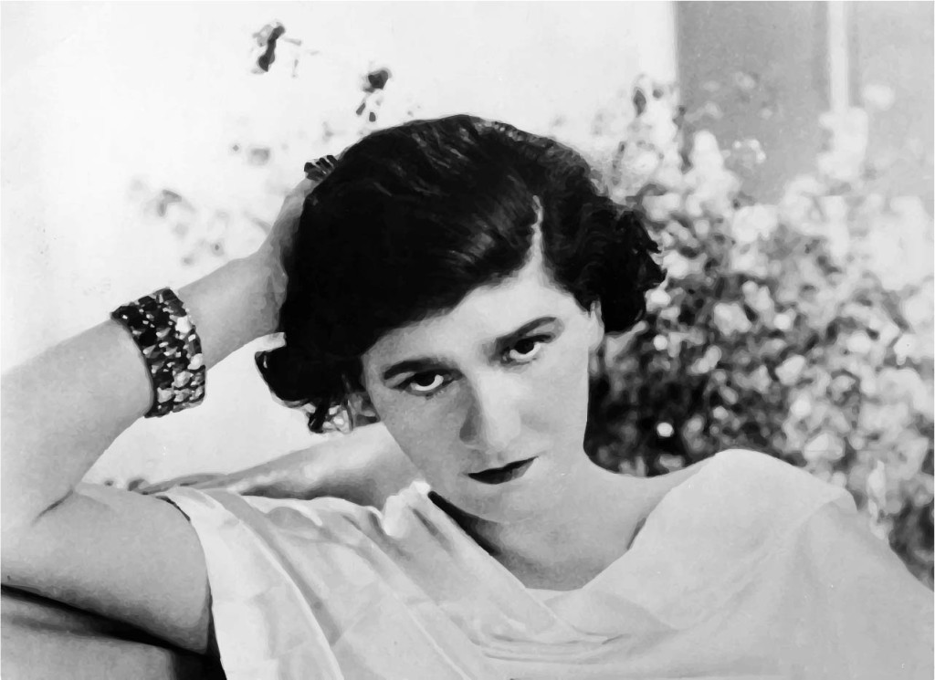 """On Sunday, Aug. 19, 1883, Gabrielle """"Coco"""" Chanel was born. Raised as an orphan, Chanel would later revolutionize the fashion world, taking elements from men's clothing to emphasize comfort over the strict constraints of then-popular women's fashion. As a woman who wears pants almost every day, thanks Coco, ya nasty female."""
